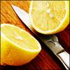 watersword: Image of a lemon, cut in half, and a knife. (Stock: lemon)